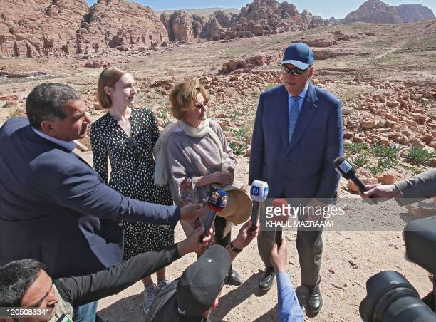 King Harald V of Norway and his wife Queen Sonja talk to reporters during their visit Jordan's archaeological city of Petra south of the capital...