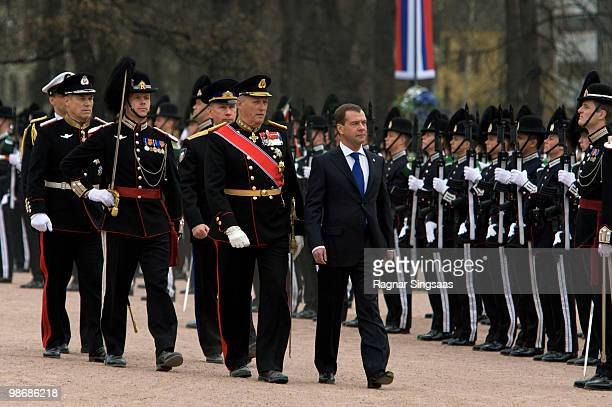 King Harald V of Norway and Russian President Dmitry Medvedev arrive at Palace Square on April 26 2010 in Oslo Norway Medvedev is in Norway for a...