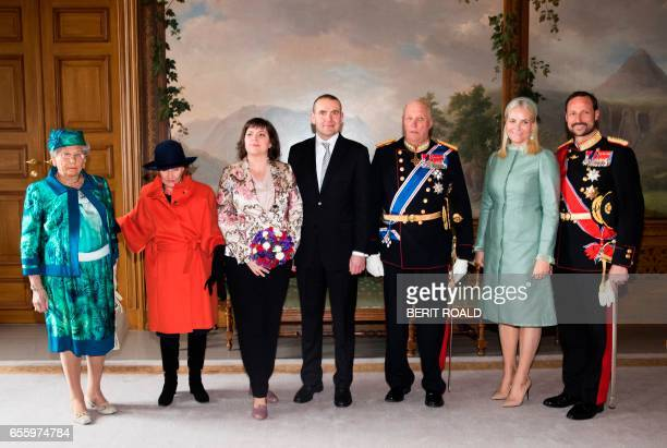 King Harald V of Norway his wife Queen Sonja of Norway their son Crown Prince Haakon of Norway and his wife MetteMarit Crown Princess of Norway and...