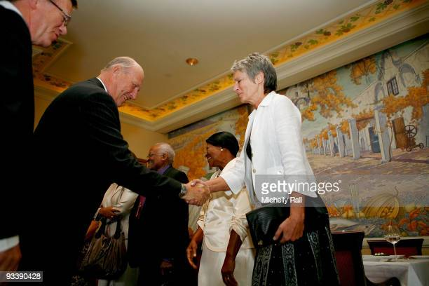 King Harald V of Norway meets with Bente Erichsen Director of the Nobel Peace Centre at Table Bay Hotel during his State Visit on November 25 2009 in...