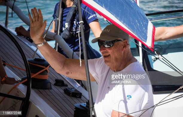 King Harald V of Norway waves on board the Fram XVI yacht on the first day of the 38th Copa del Rey Sailing Cup off the coast of Palma de Mallorca on...