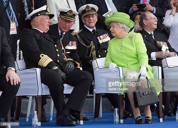 King Harold of Norway speaks to Prince Charles Prince of Wales Queen Elizabeth II and Prince Philip Duke of Edinburgh at a Ceremony to Commemorate...