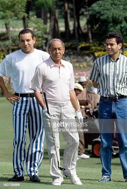 King Hassan Ii Morocco's Plays Golf With His Son. Au Maroc , le 7 septembre 1992, sur un parcours de golf, portrait du roi HASSAN II DU MAROC au...