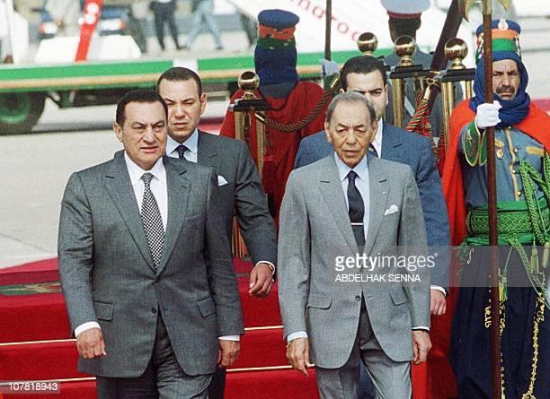 King Hassan II of Morocco and Egyptian President Hosni Mubarak review the honor guard after Mubarak's arrival in Rabat 12 June 1999 Mubarak arrived...