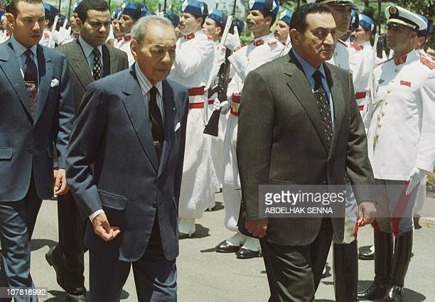 King Hassan II of Morocco and Egyptian President Hosni Mubarak review an honour guard 13 June 1999 at the Rabat Royal Palace followed by Morocco's...