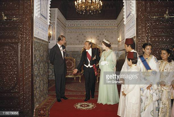 King Hassan II of Morocco and his family with Queen Elizabeth II and Prince Philip at the royal palace in Rabat during a state visit to Morocco, 28...