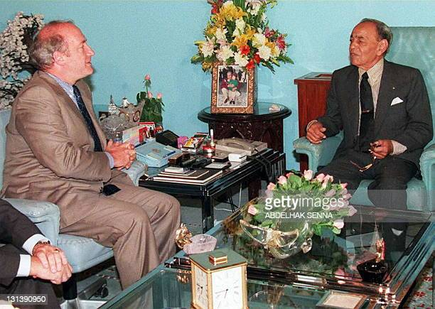 King Hassan II of Morocco discuss with French Foreign Minister Hubert Vedrine in the Royal summer Palace of Skhirat near Rabat 28 July after the...