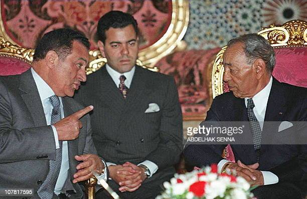 King Hassan II of Morocco listens to Egyptian President Hosni Mubarak 14 May at the royal palace in Rabat as Moroccan Prince Moulay Rachid looks on...