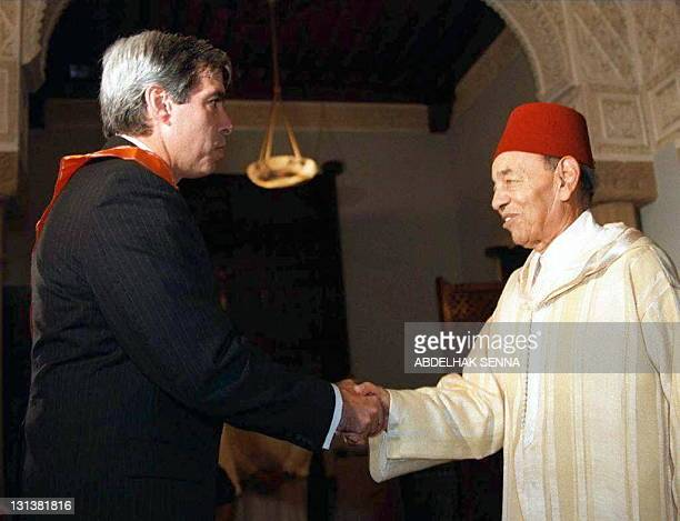 King Hassan II of Morocco shakes hand with US Ambassador to Morocco Marc Charles Ginsberg 08 January in Rabat as the US Ambassador came to greet the...