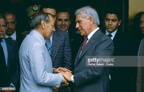 King Hassan II of Morocco shakes hands with Algerian President Chadli Bendjeddid at the close of the Algiers Summit, during which Arab leaders...