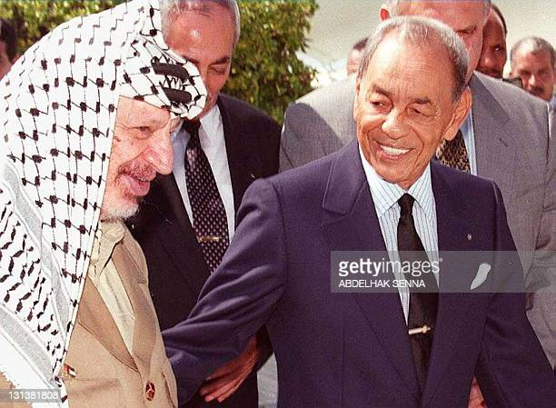 King Hassan II of Morocco smiles broadly as he greets Palestinian Authority leader Yasser Arafat at the Skhirat Royal Palace in Rabat 30 September...