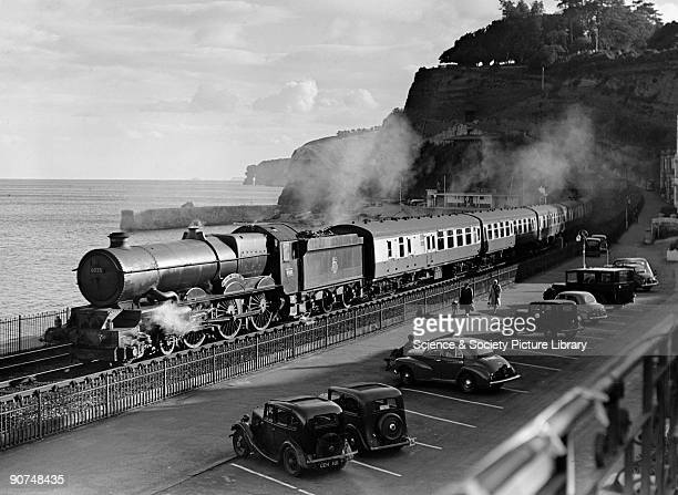 King Henry III' locomotive No 6025 emerges from Kennoway Tunnel Dawlish Devon 1955 The steam locomotive is seen here as it runs alongside the sea...