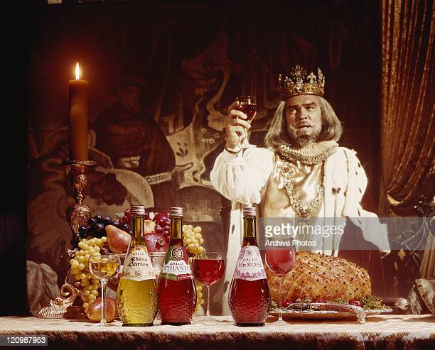 King holding wine glass