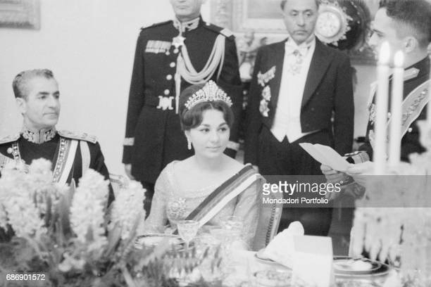 King Husayn of Jordan making a speech during the party in his honor in front of the Persian Shah Mohammad Reza Pahlavi and his wife Farah Diba...