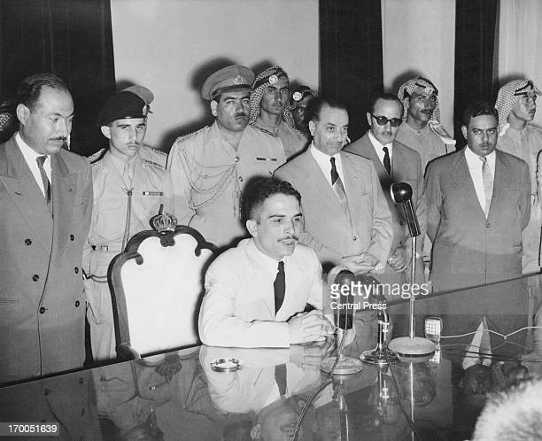King Hussein gives a press conference in Amman Jordan 25th August 1958 Crown Prince Muhammad can be seen behind second from left wearing a black beret