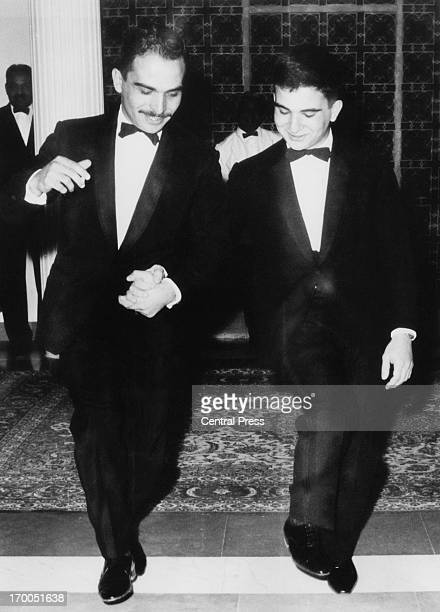 King Hussein holds the hand of his younger brother Prince Hassan bin Talal and demonstrates the Dabke a Jordan folk dance Amman Jordan 12th April 1965