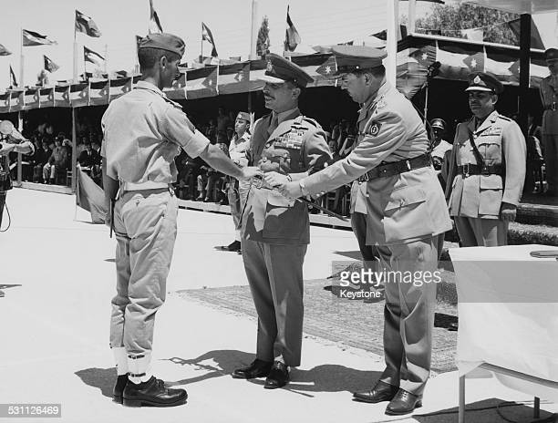 King Hussein of Jordan attends the graduation ceremony of new army cadets on the 17th anniversary of his accession to the throne Jordan 11th August...