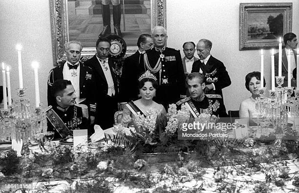 King Hussein of Jordan Empress of Iran Farah Pahlavi and Shah of Iran Mohammad Reza Pahlavi sitting at the table on the occasion of the gala at...