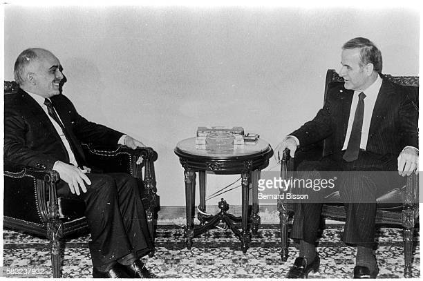 King Hussein of Jordan meets with Syrian President Hafez al-Assad in the Syrian capitol of Damascus.