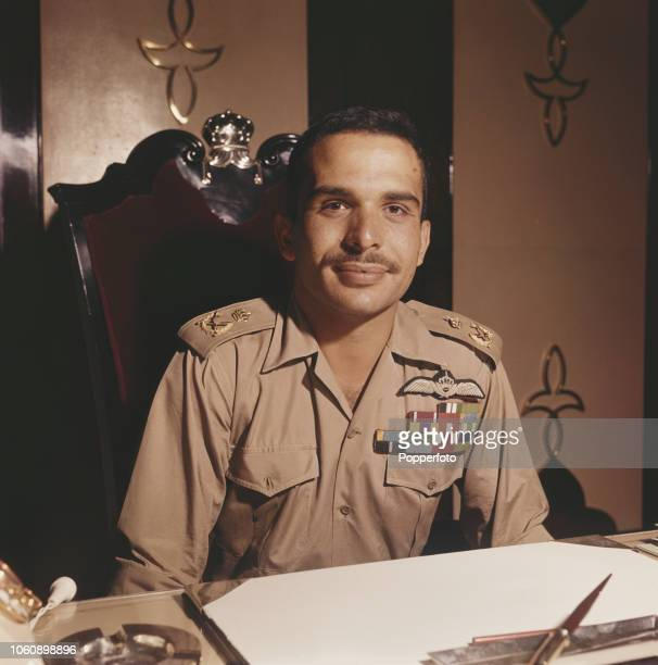 King Hussein of Jordan pictured wearing military uniform seated at a desk in Amman Jordan in November 1960