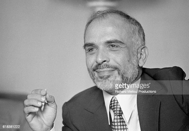 King Hussein of Jordan smokes a cigarette during a press conference for Arabic journalists based in Paris during his visit to France to meet with...