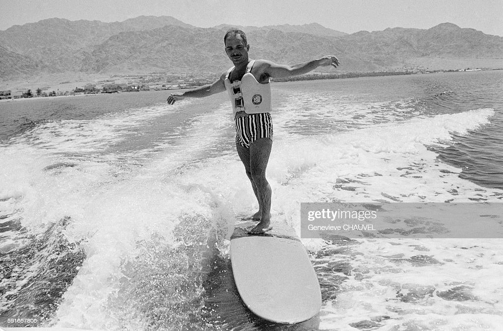 king-hussein-of-jordan-surfs-the-waves-created-by-a-boat-on-the-lake-picture-id591657806