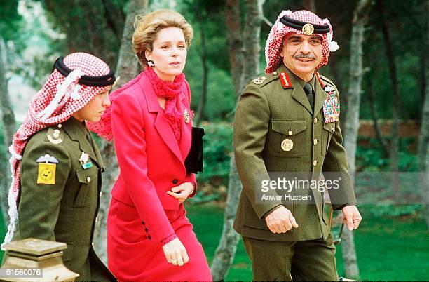 King Hussein of Jordan walks with his wife Queen Noor of Jordan and son Abdullah, now King Abdullah II, in March 1984 in Amman, Jordan.