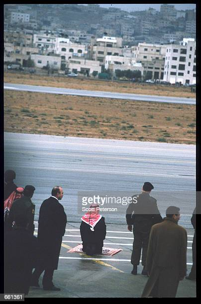 King Hussein prays at the airport upon his arrival January 19 1999 in Amman Jordan King Hussein returns after spending six months at the Mayo clinic...