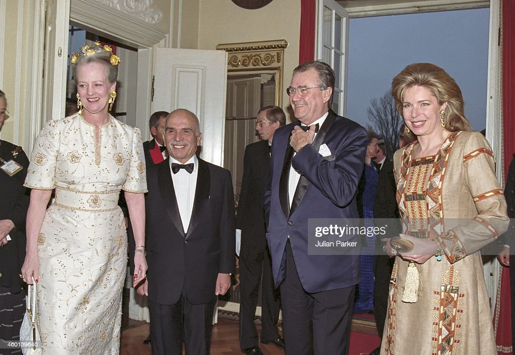 King Hussien of Jordan, and Queen Noor of Jordan with Queen Margrethe of Denmark (left ), and Prince Henrik of Denmark ( 2nd right) , attend a return Dinner, at Solyst Restaurant, near Copenhagen, during their State visit to Denmark. on April 28, 1998, in Copenhagen, Denmark.