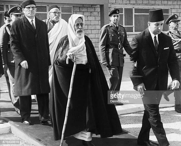 King Idris of Libya is flanked by officials as he arrives the opening ceremony of the new Libyan Oil Terminal at Marsa Al Hariga, February 14th 1967.