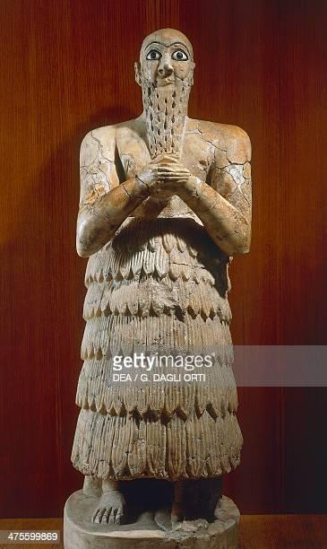 King Itur Shamagan in prayer dress and kaunakes fleece cloak made from goat hair or wool alabaster statue from Mari Tell Hariri Syria Sumerian...