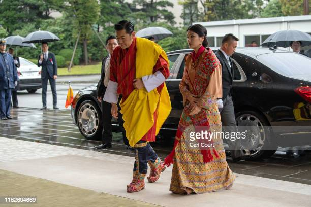 King Jigme Khesar Namgyel Wangchuck and Queen Jetsun Pema of Bhutan arrive to attend the Enthronement Ceremony Of Emperor Naruhito of Japan at the...