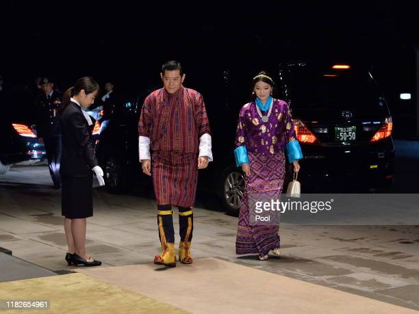 King Jigme Khesar Namgyel Wangchuck and Queen Jetsun Pema of Bhutan arrive to attend the Court Banquet at the Imperial Palace on October 22 2019 in...