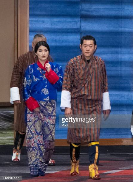 King Jigme Khesar Namgyel Wangchuck and Queen Jetsun Pema of Bhutan arrive at the cocktail party before the banquet hosted by the Prime Minister of...