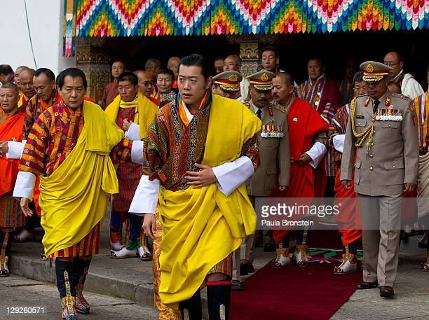 King Jigme Khesar Namgyel Wangchuck arrives at the Tashichho Dzong before an early prayer morning ceremony at the Chamber of the Golden Throne for...