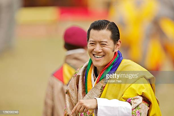 King Jigme Khesar Namgyel Wangchuck smiles at the villagers as he walks around the celebration ground on October 13 2011 in Punakha Bhutan King Jigme...