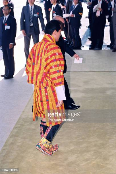 King Jigme Singye Wangchuck of Bhutan is seen on arrival at the Imperial Palace to attend the 'SokuinoRei' Emperor's Enthronement Ceremony at the...