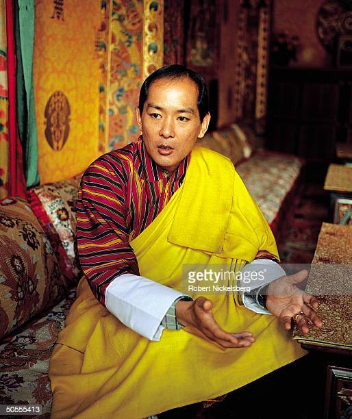 King Jigme Singye Wangchuck of Bhutan speaking in serious portrait in TIME interview
