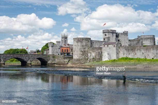 king john's castle, limerick, ireland. man fishing - limerick city stock-fotos und bilder