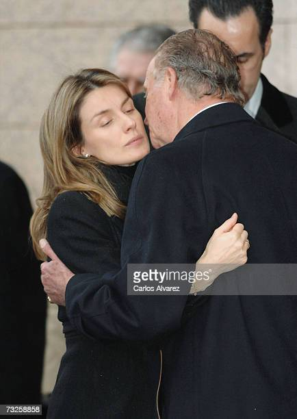 King Juan Carlos and Princess Letizia of Spain embrace during the funeral for Erika Ortiz younger sister of Princess Letiza on February 08 2007 at La...