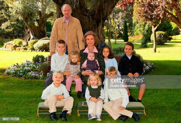 King Juan Carlos and Queen Sofia in the gardens of the Zarzuela Palace with their eight grandchildren for this year's family Christmas card |...