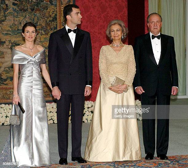King Juan Carlos and Queen Sofia of Spain pose for a picture with Crown Prince Felipe and his fiancee Letizia Ortiz Rocasolano as they attend a gala...