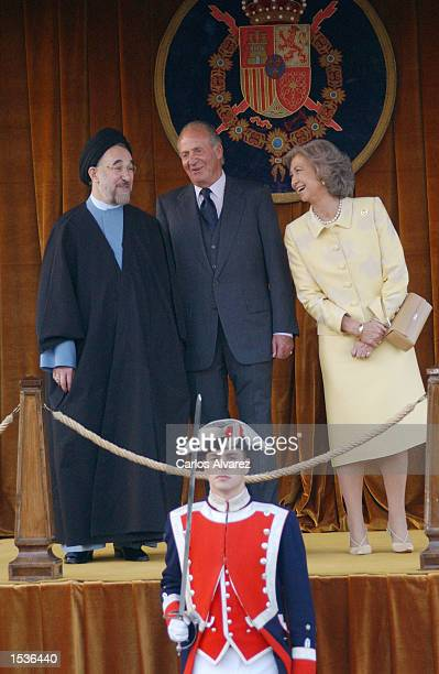 King Juan Carlos and Queen Sofia of Spain stand with Iranian President Mohammad Khatami as they watch a military parade October 28 2002 at El Pardo...