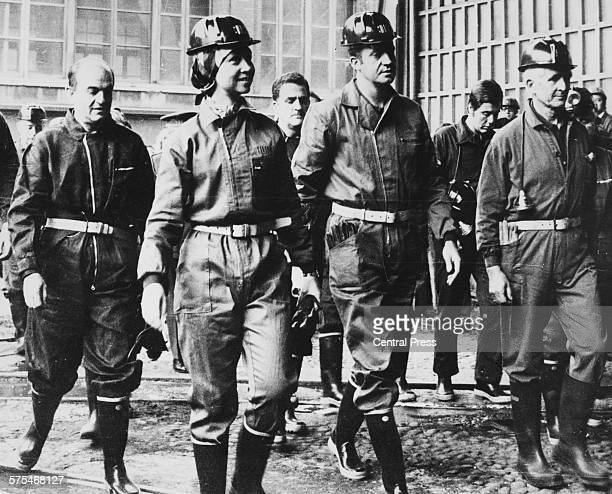 King Juan Carlos and Queen Sofia of Spain wearing overalls and miners helmets as they tour a coal mine during a visit to Asturias May 27th 1976