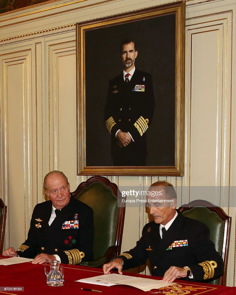 King Juan Carlos (L), close to a painting of his son King Felipe VI, attends Naval Museum board meeting on November 8, 2017 in Madrid, Spain.
