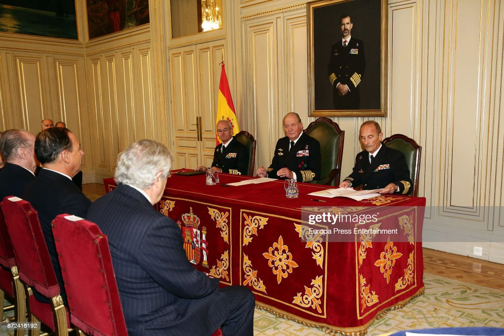 King Juan Carlos (2R), close to a painting of his son King Felipe VI, attends Naval Museum board meeting on November 8, 2017 in Madrid, Spain.