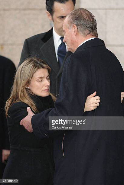 King Juan Carlos comforts Princess Letizia of Spain during the funeral for Erika Ortiz younger sister of Princess Letiza on February 08 2007 at La...