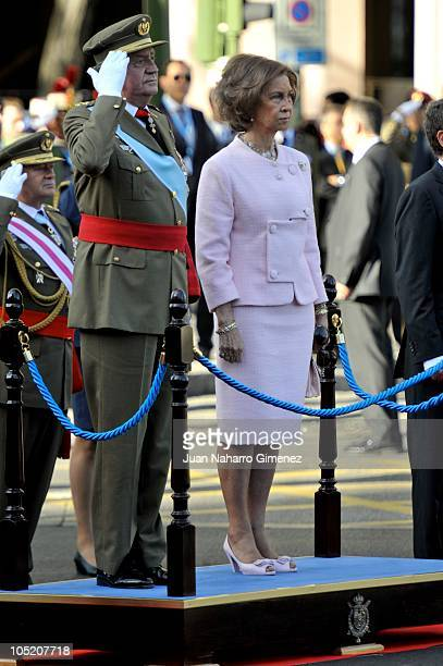 King Juan Carlos I of Spain and Queen Sofia of Spain attend National Day Military Parade in the Paseo de la Castellana on October 12 2010 in Madrid...