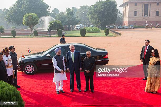 King Juan Carlos I of Spain poses with Indian Prime Minister Manmohan Singh and Indian President Pranab Mukherjee during his ceremonial reception at...