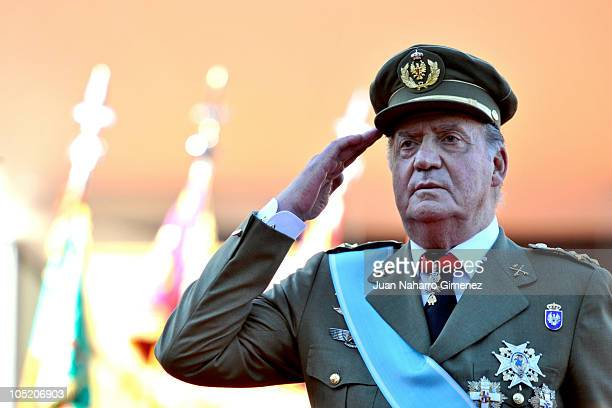 King Juan Carlos I of Spain salutes during National Day Military Parade in the Paseo de la Castellana on October 12, 2010 in Madrid, Spain.